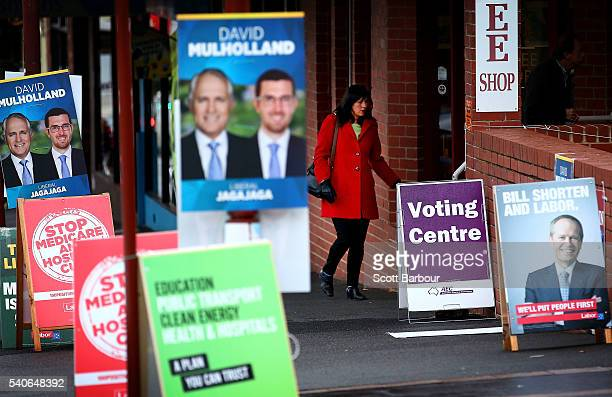 A woman arrives at a prepoll voting centre for the 2016 federal election on June 16 2016 in Melbourne Australia PrePoll voting centres opened across...
