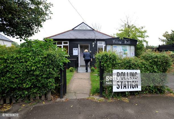 A woman arrives at Little Burstead Village Hall in Essex to cast her vote in the local council elections