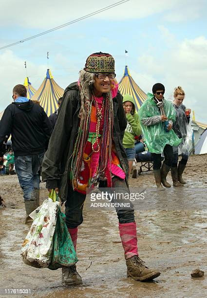 A woman arrives during the opening day of the Glastonbury festival near Glastonbury Somerset on June 23 2011 Veteran Irish band U2 are set to rock...