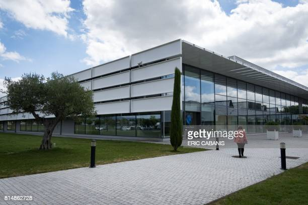 A woman arrives to the production plant of French multinational pharmaceutical and cosmetics company 'Pierre Fabre' in Soual on July 13 2017 / AFP...