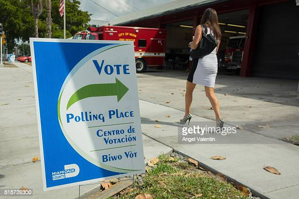 A woman arrives to vote at a fire station on March 15 2016 in Miami Florida Voters cast ballots in the presidential primary in Illinois Missouri...