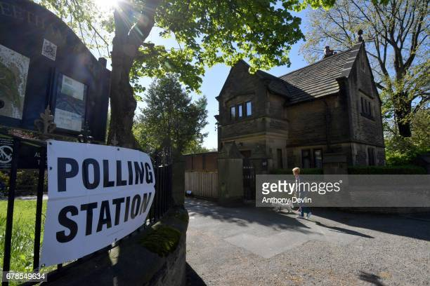 A woman arrives with her dog at a polling station in Stalybridge Tameside during the Manchester Mayoral election on May 4 2017 in Manchester England...