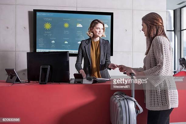 Woman arriving at reception desk