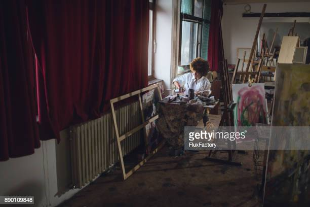 Woman artist working at her studio