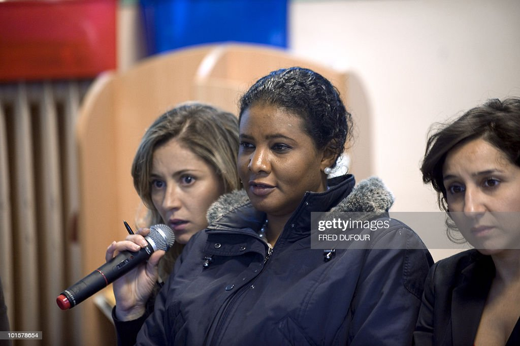 A woman asks a question near Sihem Habchi (R), President of the French Women's rights association 'Ni putes ni soumises' (Neither whores nor submissive) and Sudan's journalist Loubna Ahmed al-Hussein (C) on May 18, 2010 in Evry, outside Paris during a public debate on the full-face Islamic veil.The French parliament unanimously adopted on May 11, 2010 a resolution condemning the full-face Islamic veil as an affront to the nation's values.
