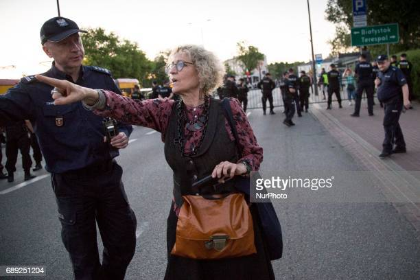 Woman asks policeman about safe way during strike near Powszechny theatre in Warsaw on May 27 2017 Sitin strike named quotProtest of the defenders of...