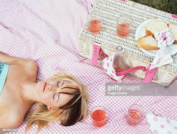 Woman asleep at a picnic