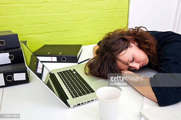 Woman asleep at her desk