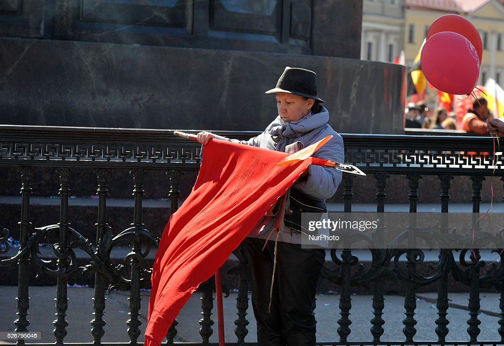 A woman assembles flag after the May Day demonstration in St. Petersburg, Russia, on May, 1, 2016. Labor Day or May Day is observed all over the world on the first day of the May to celebrate the economic and social achievements of workers and fight for laborers rights.