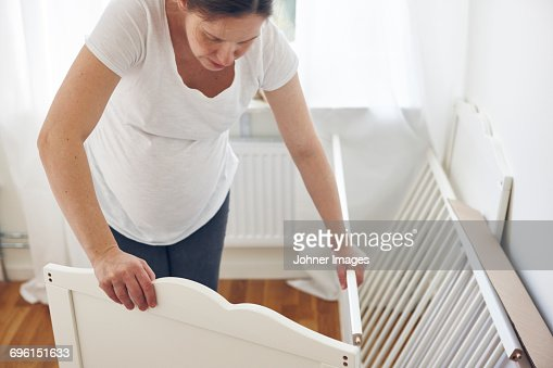 Woman assembling cot