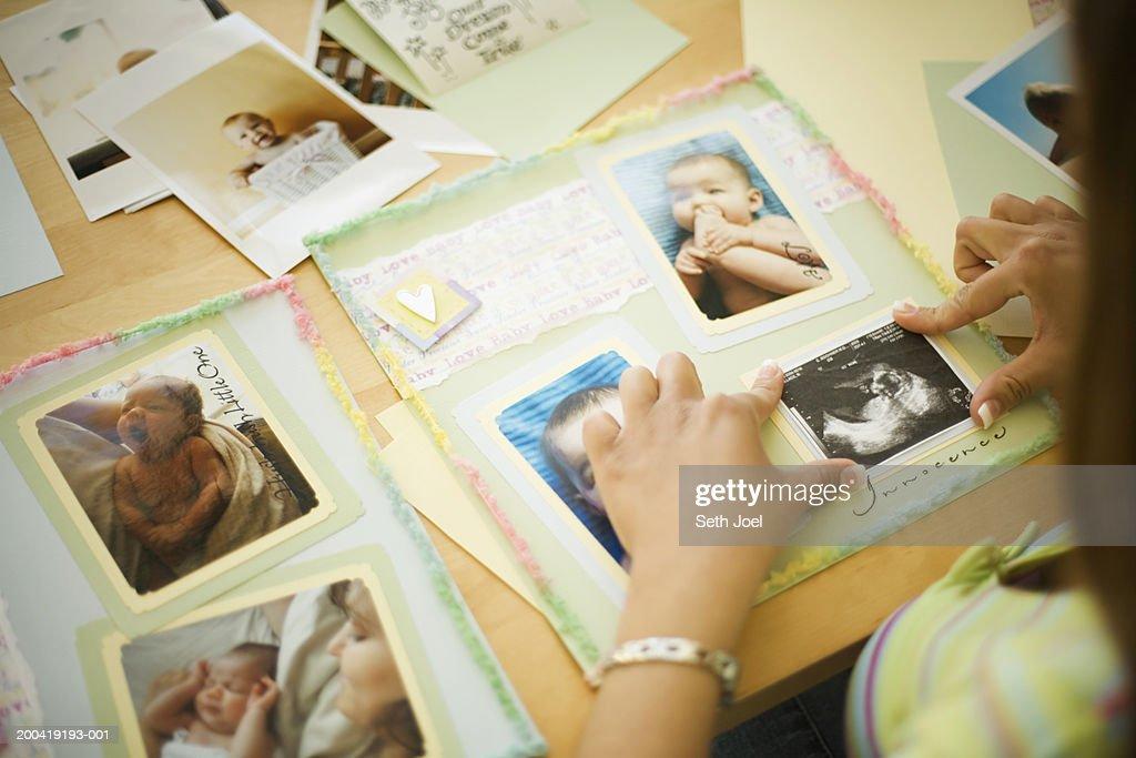 Woman assembling scrapbook : Stock Photo