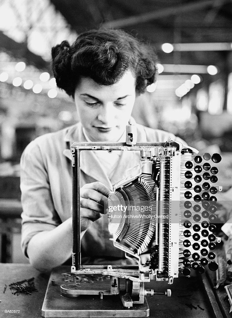Woman assembling typewriter in factory (B&W) : Stock Photo