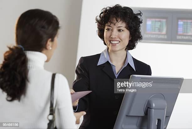 A woman at a desk assisting a customer
