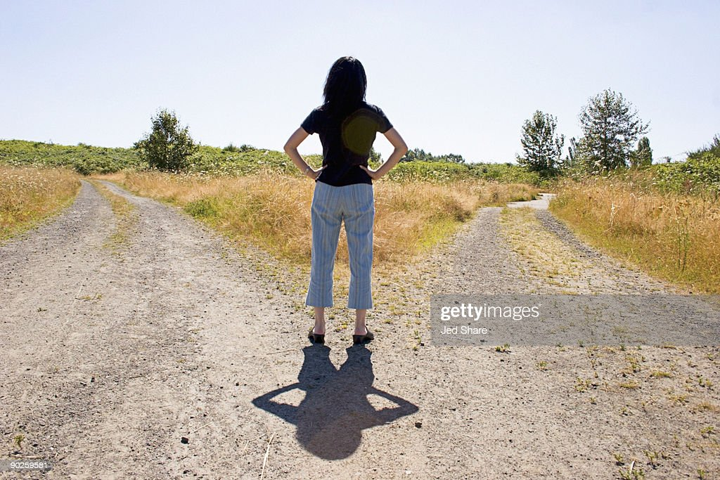 Woman at a forked road : Stock Photo
