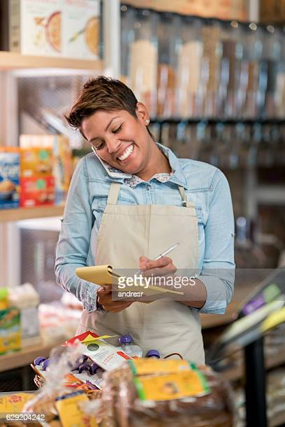Woman at a grocery store talking on the phone