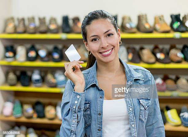 Woman at a shoe store holding a business card
