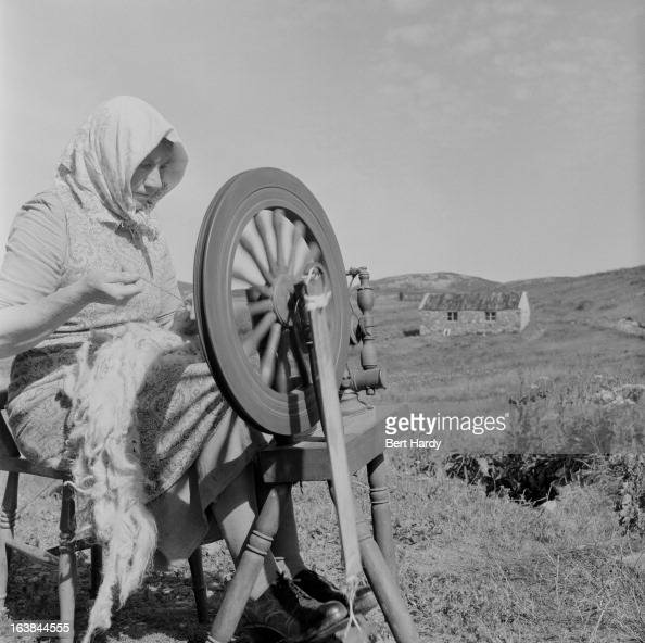 A woman at a spinning wheel on Lewis part of the island of Lewis and Harris in the Outer Hebrides of Scotland 12th August 1955 Original Publication...