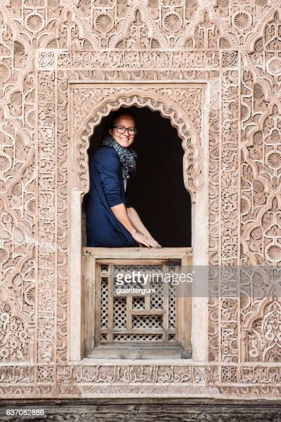 Woman at a window of Madrasa ben Youssef, Marrakesh, Morocco