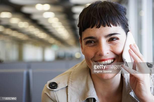 Woman at Airport phoning