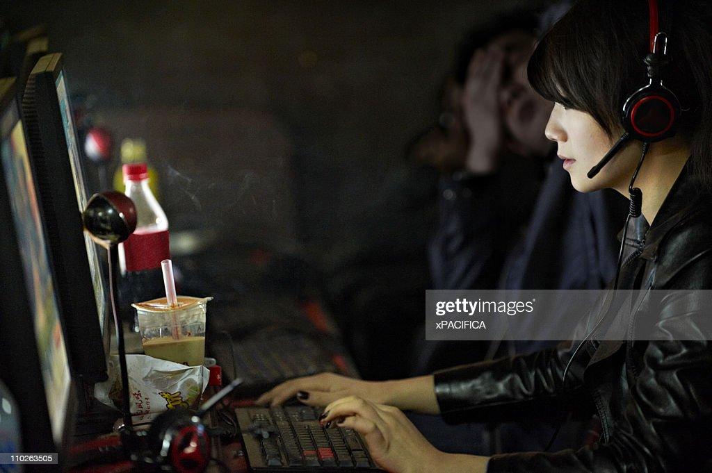 A woman at an internet cafe.