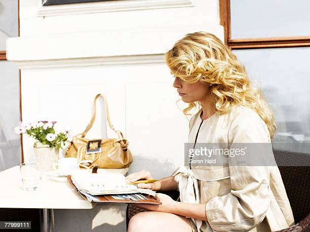 Woman at an outdoor restaurant with her day planner