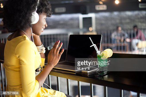 Woman at cafe have a web chat.