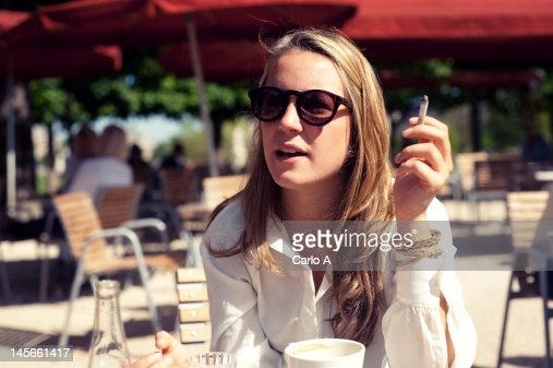 Woman at cafe : Stock Photo