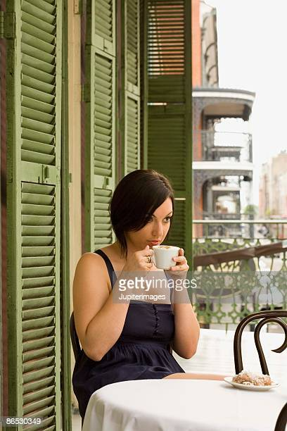 Woman at cafe with food and coffee