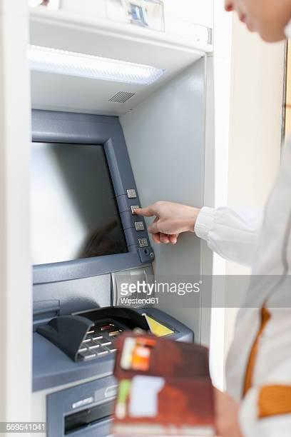 Woman at cash machine