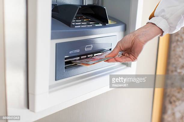Woman at cash machine