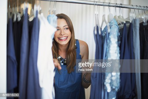 Woman at clothing rack : Photo