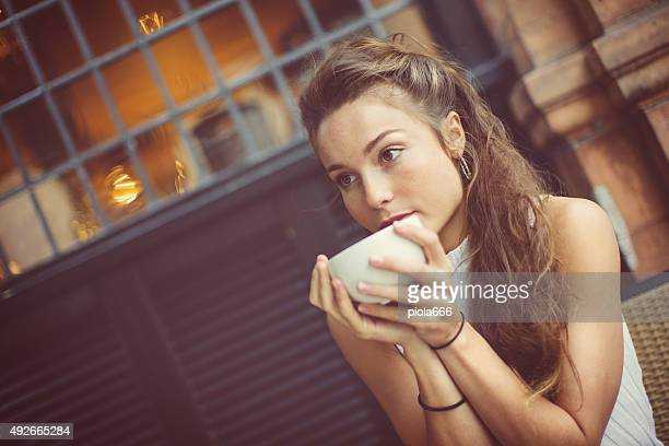 Woman at coffee shop in London