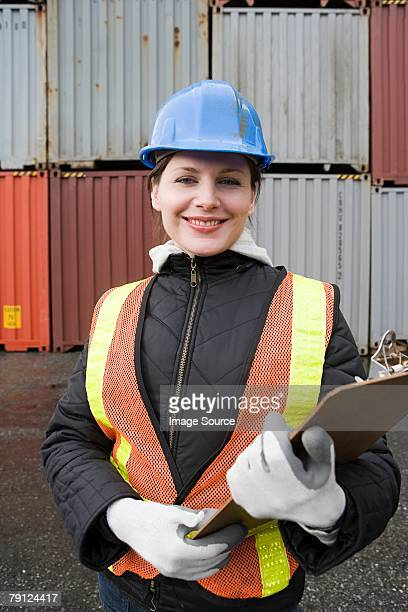 Woman at container terminal