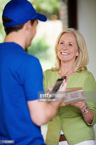 Woman at door with delivery man