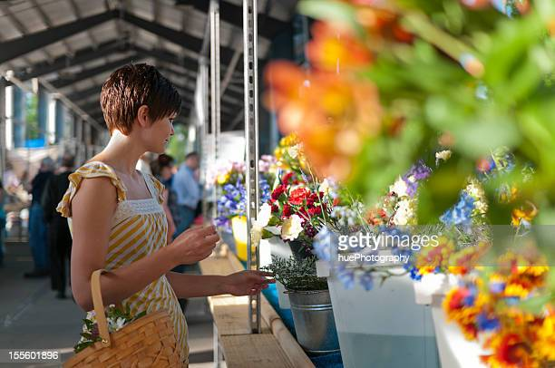 Woman at farmers market with flowers