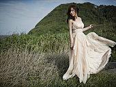 Woman at grassy plain