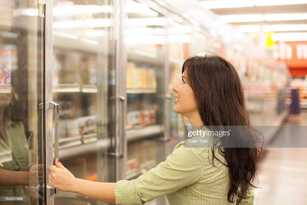 Woman at  grocery store : Stock Photo