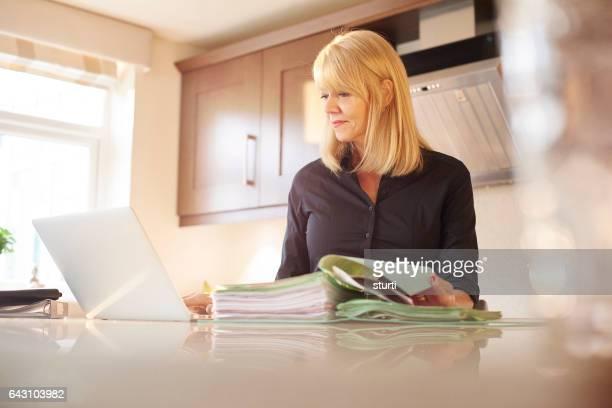 woman at home checking bills