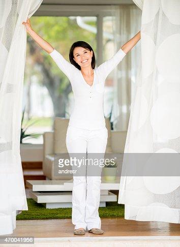 Woman at home enjoying the fresh air