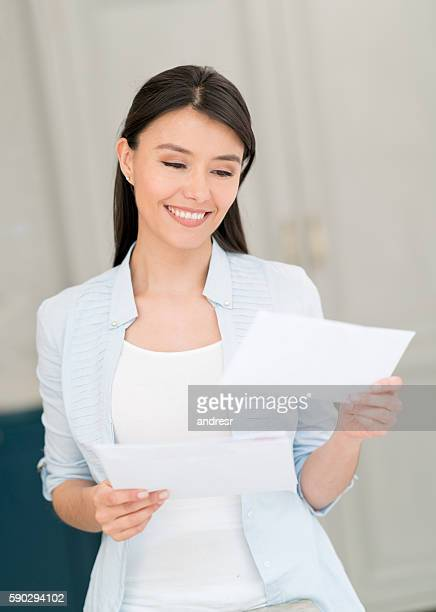 Woman at home getting the mail