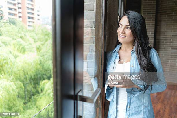 Woman at home having a glass of milk