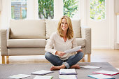 Woman at home looking at papers