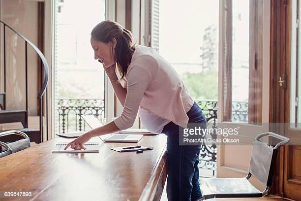 Woman at home making phone call