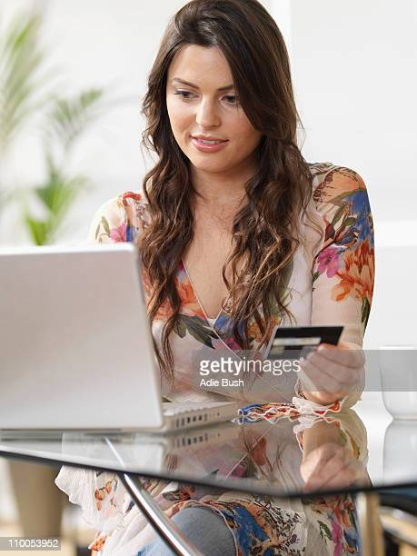 Woman at home shopping online