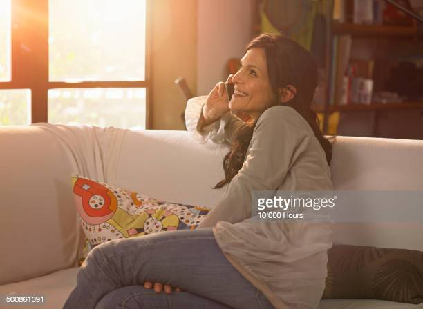 Woman at home talking on the phone