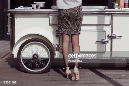 Woman at hotdog stand