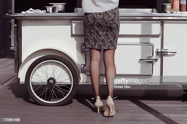 Woman at hotdog stand