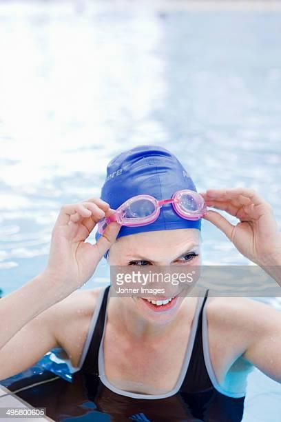 Woman at indoor swimming pool