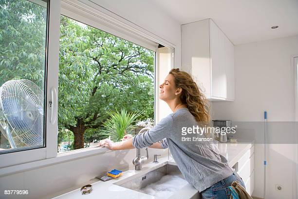 Woman at kitchen window