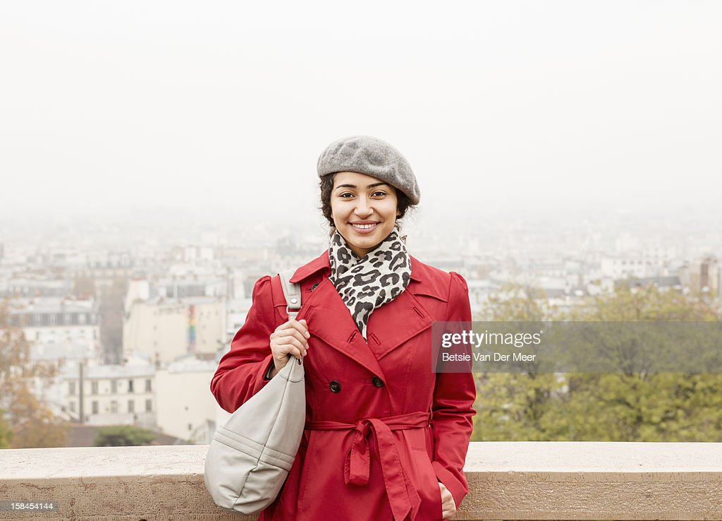 Woman at Montmatre, view of Paris behind her : Stock Photo